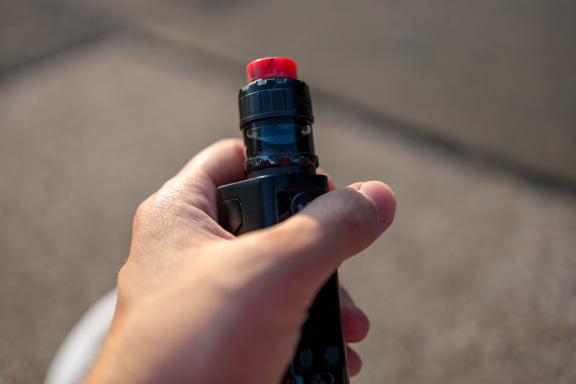 E-cigarette in hand