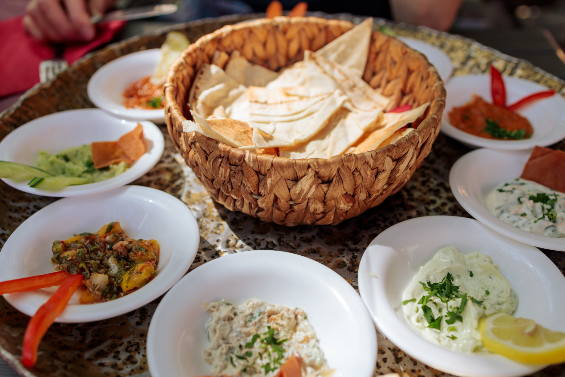 Arabic appetizer plate with dips and pita bread