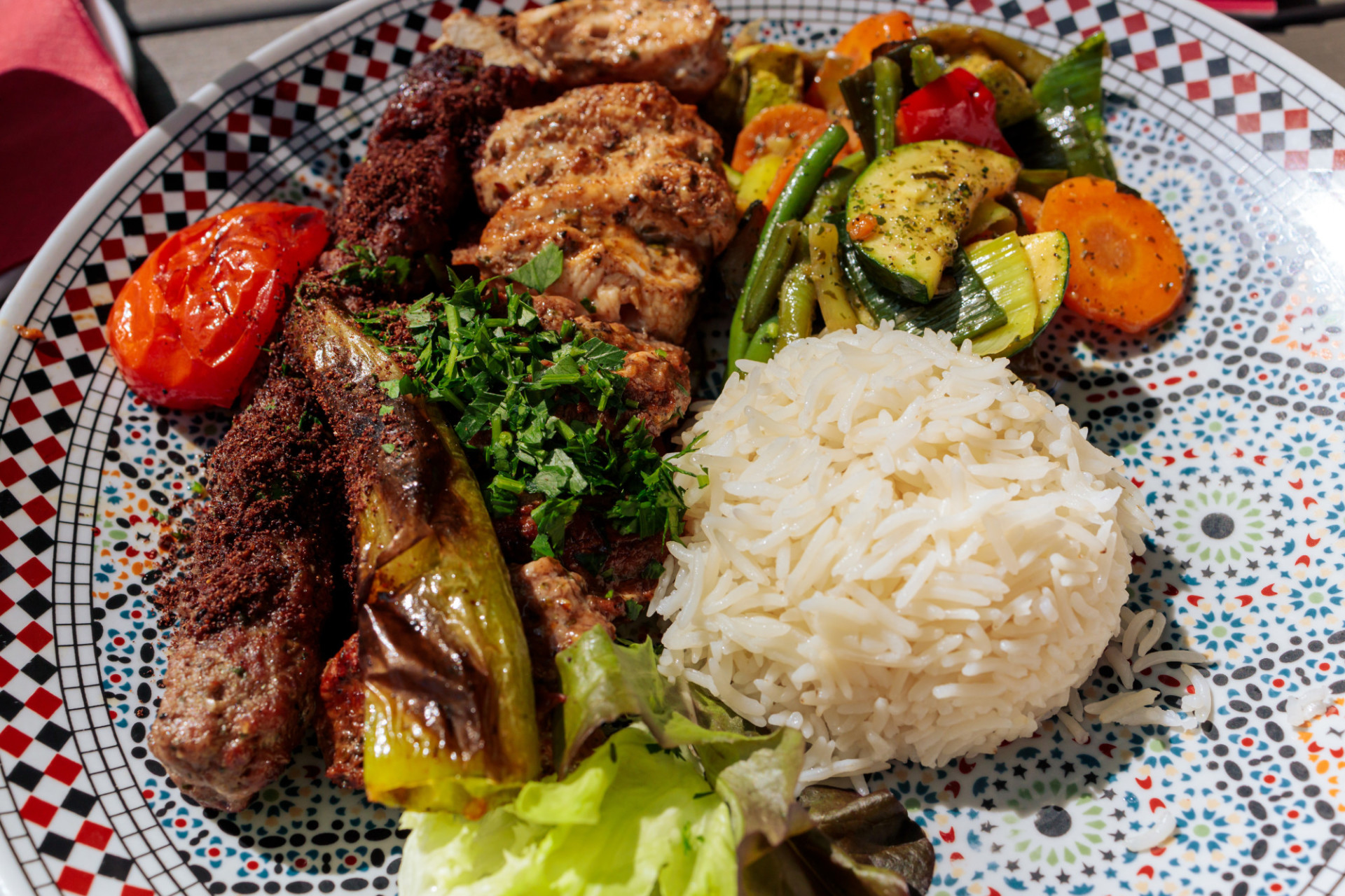Arabic meat kebabs with rice and grilled vegetables