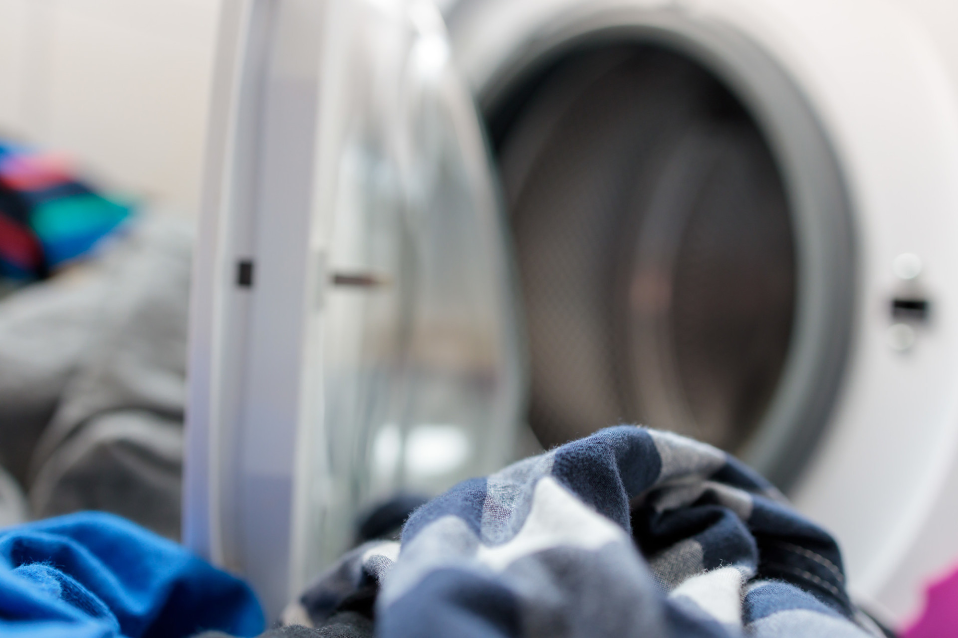 Dirty laundry in front of a washing machine