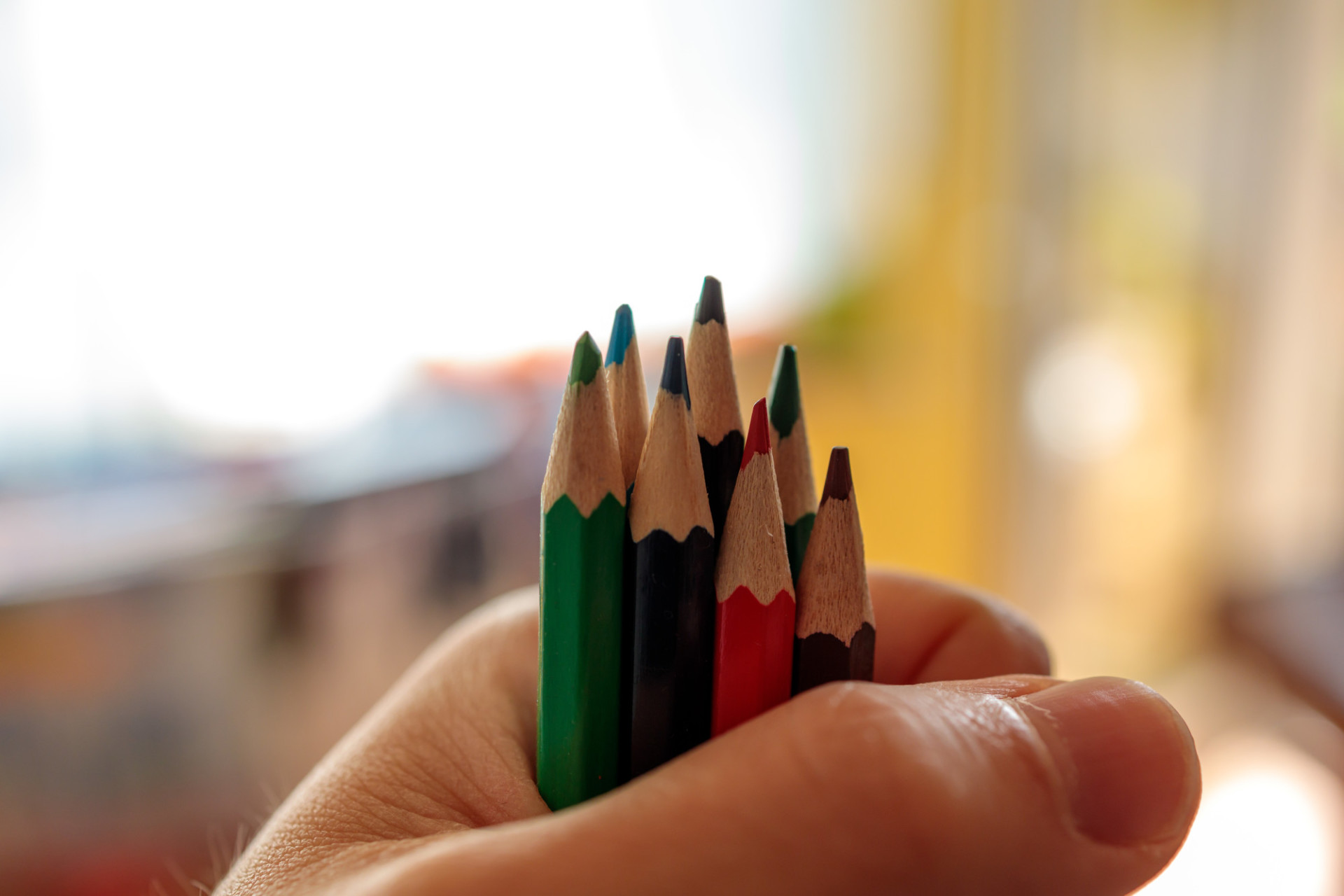 A pile of crayons firmly in hand