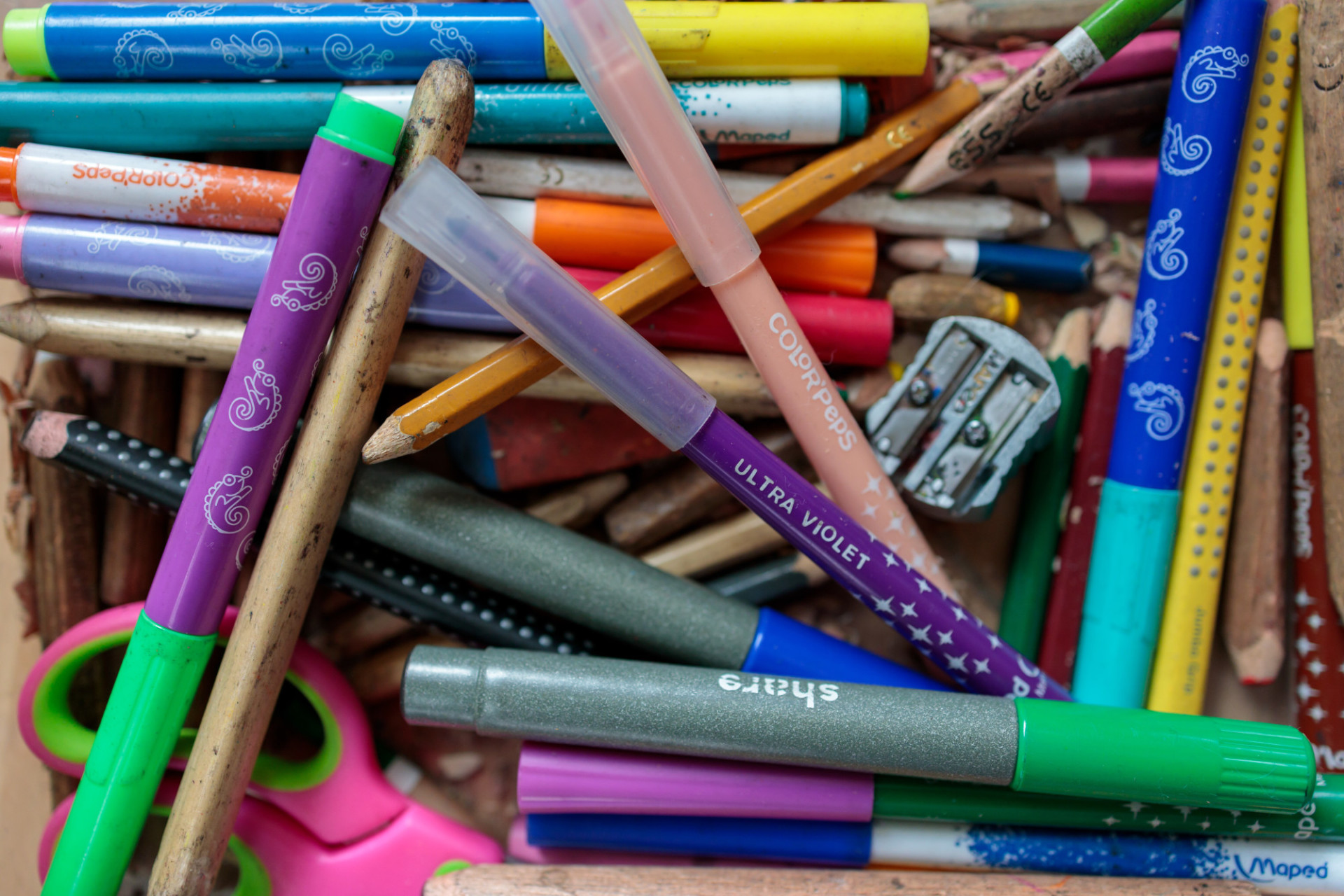 Various coloured pencils in a box