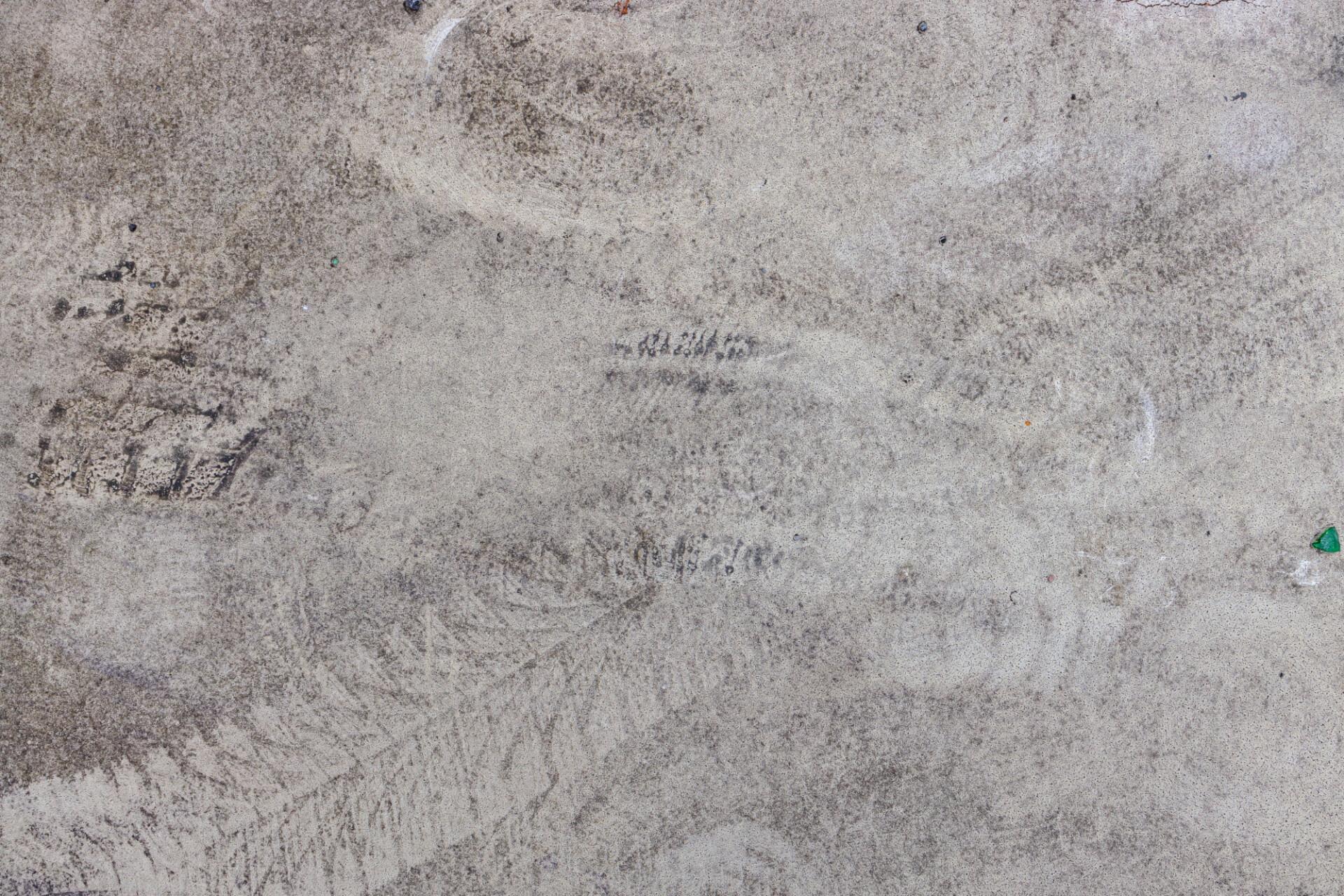 Concrete floor texture with car tyre tracks
