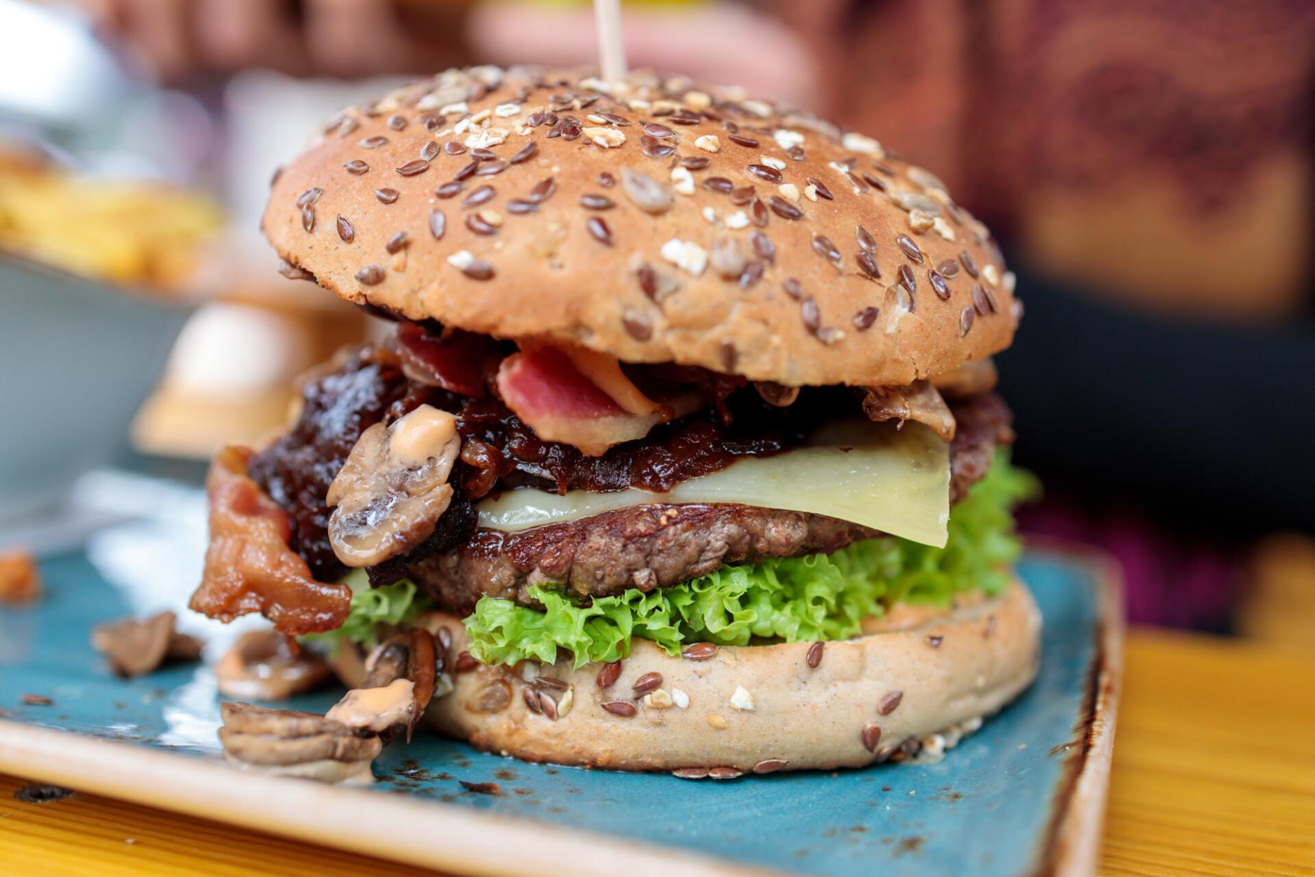 Hamburger with onions cheese and mushrooms