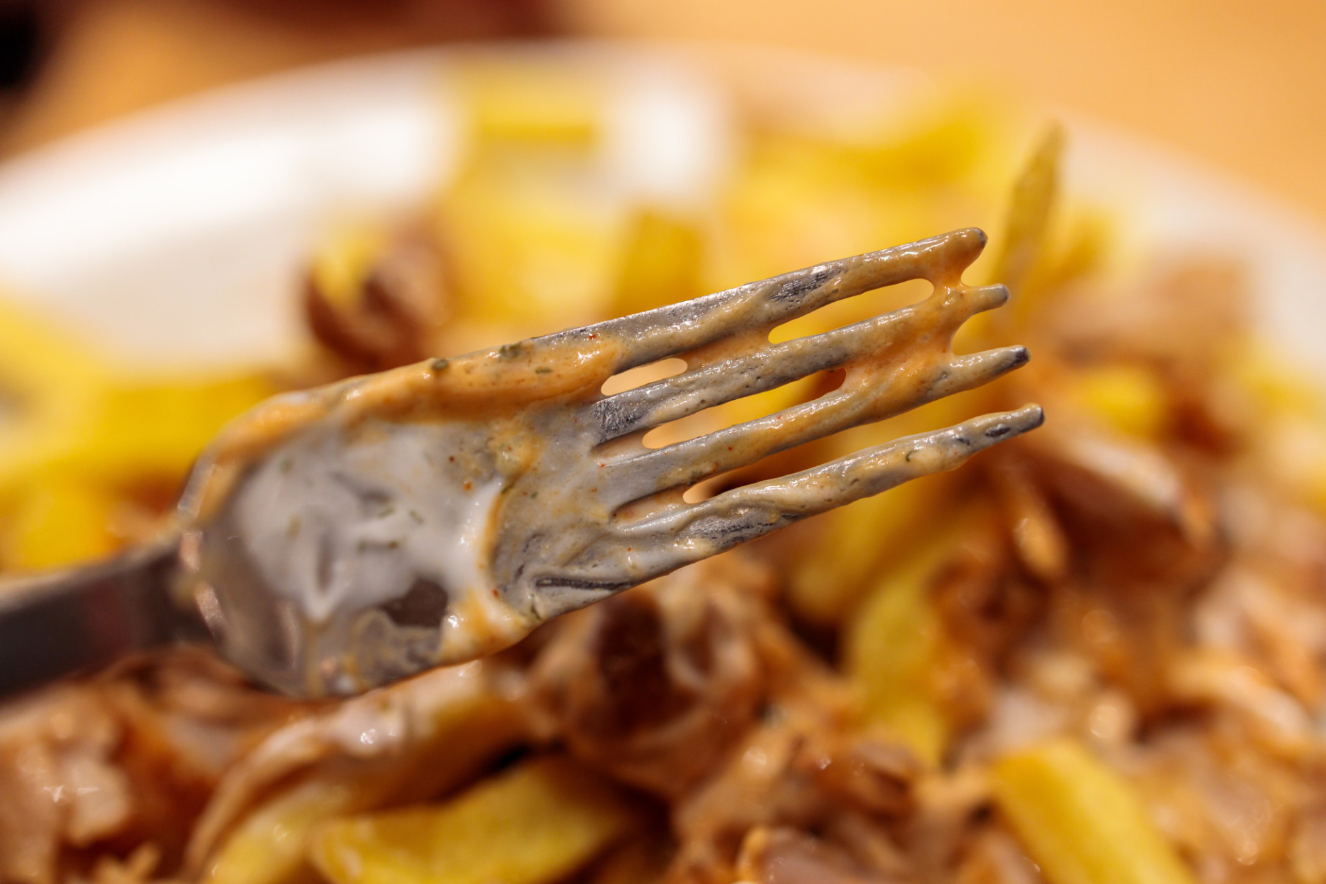 Fork smeared with sauce