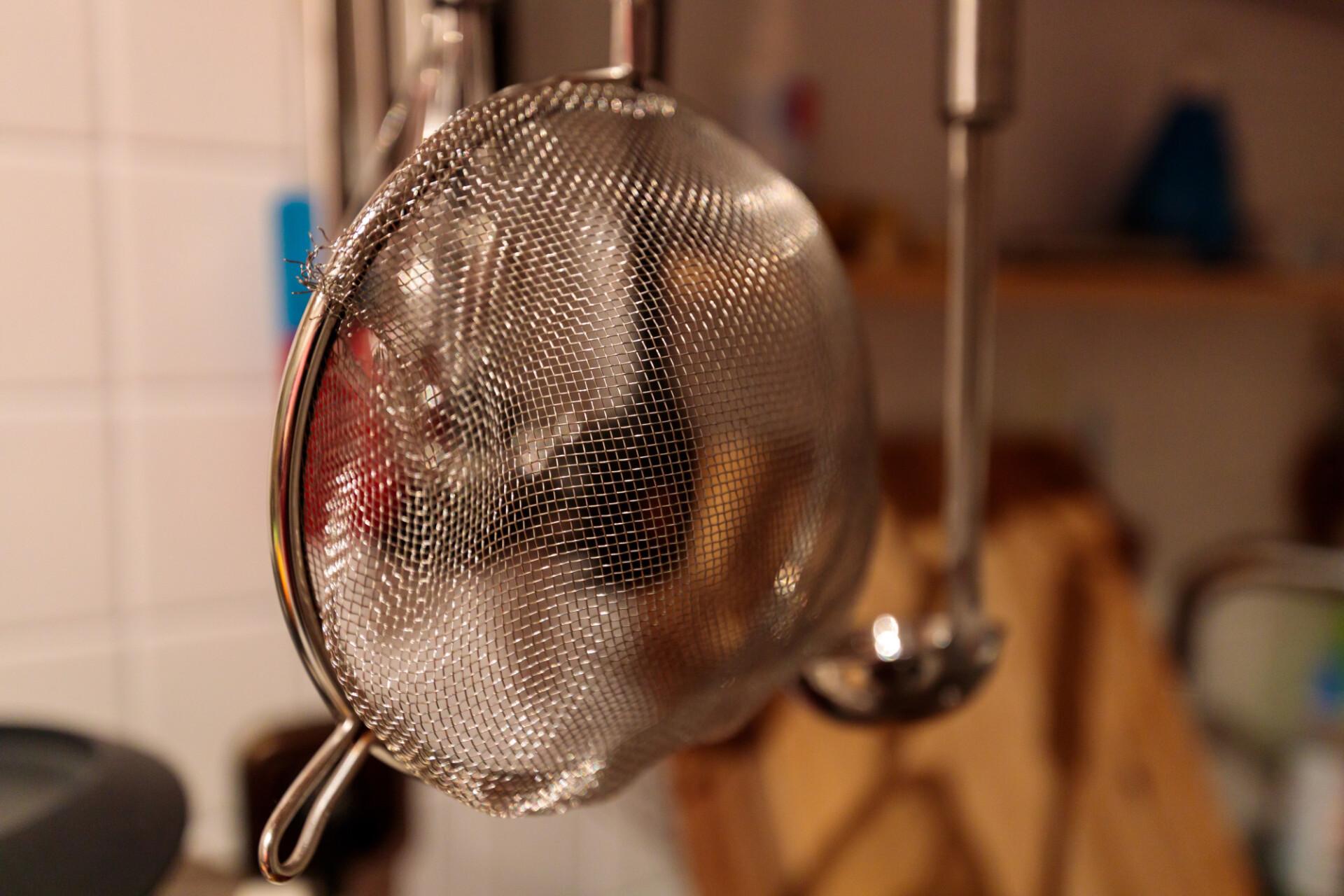 Kitchen colander hanging over the sink