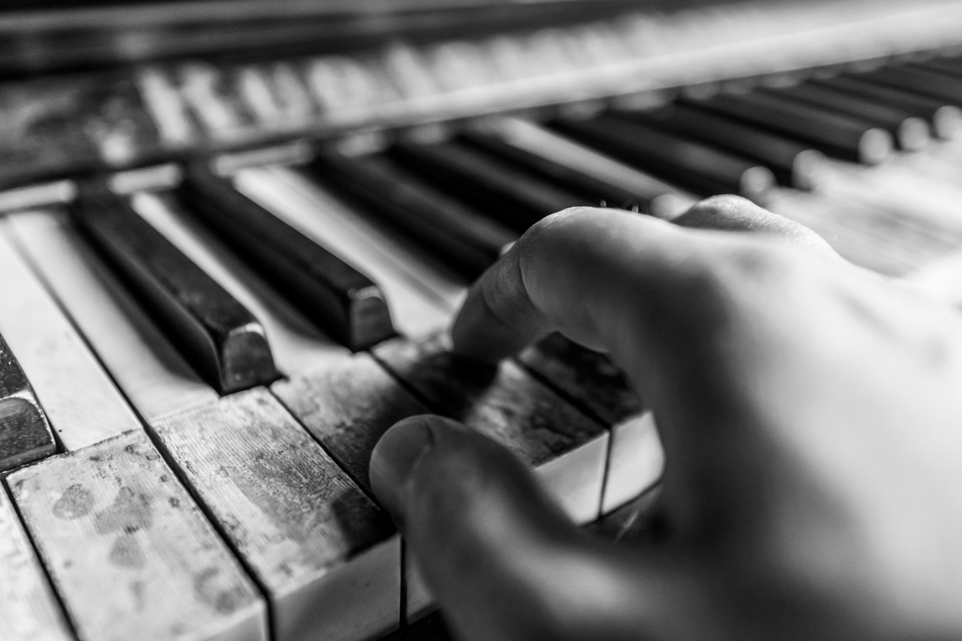 Playing on an old broken piano