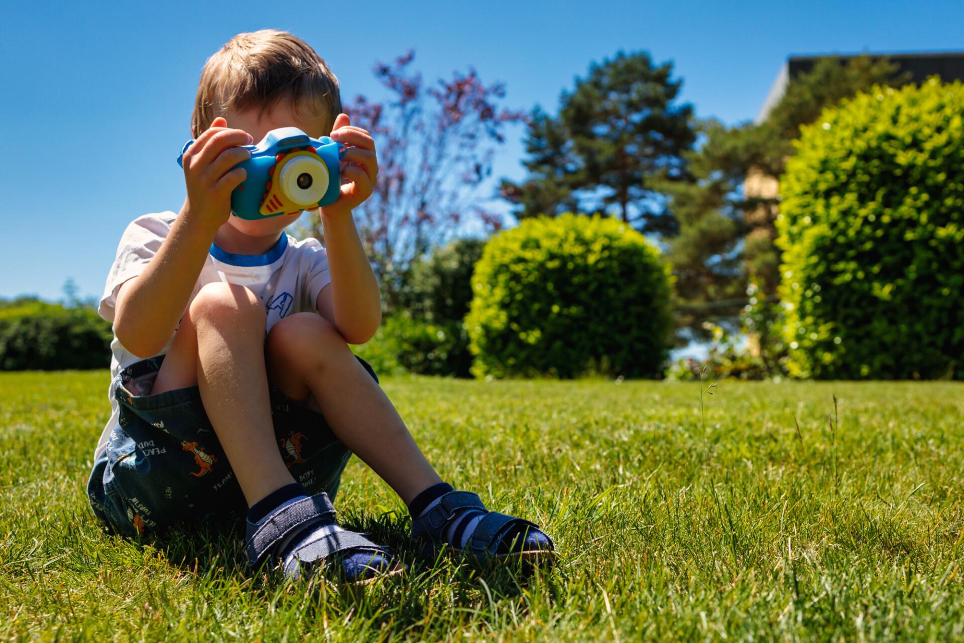 Small child with child camera