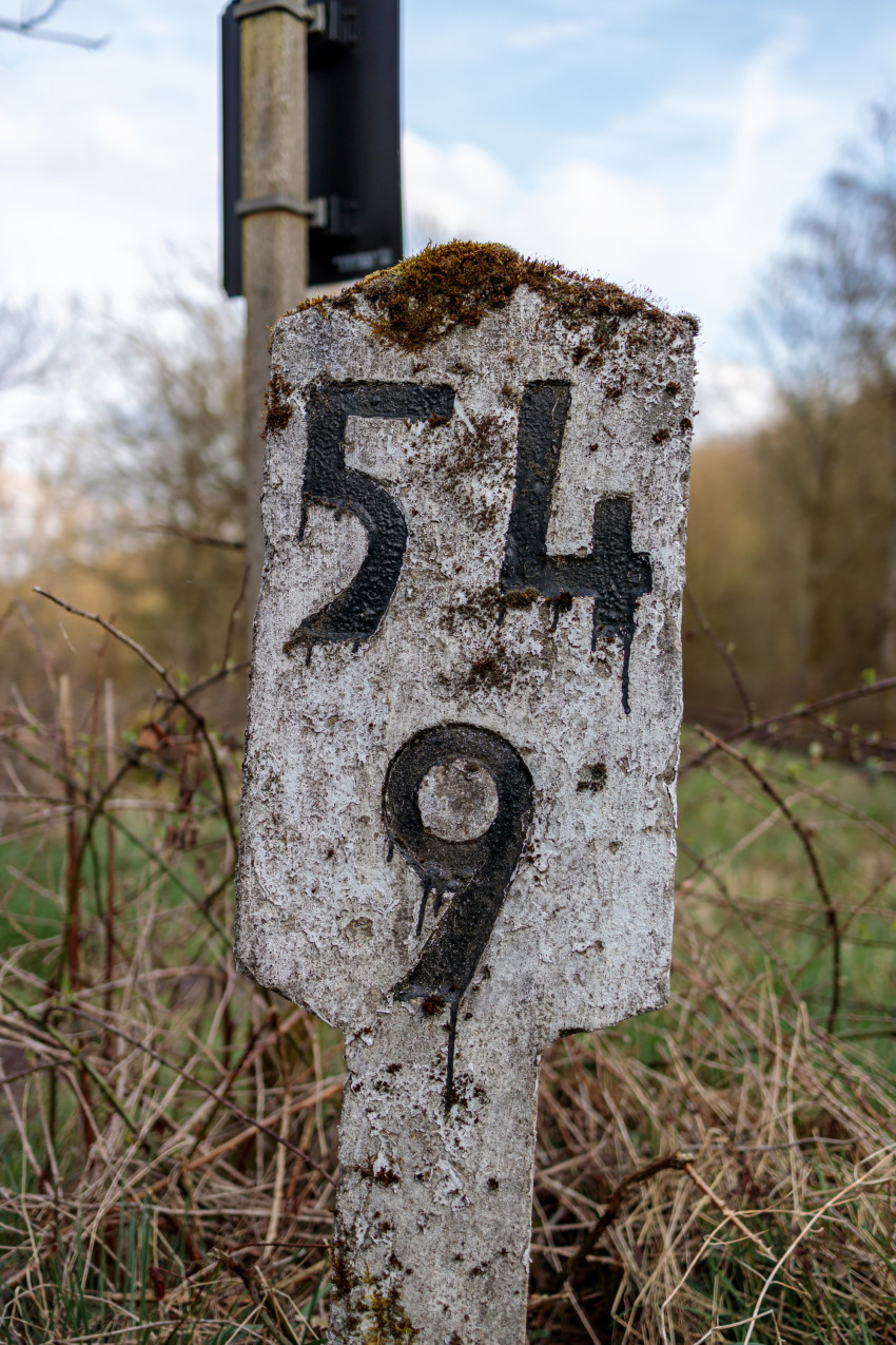 Old train sign with the numbers 54 and 9