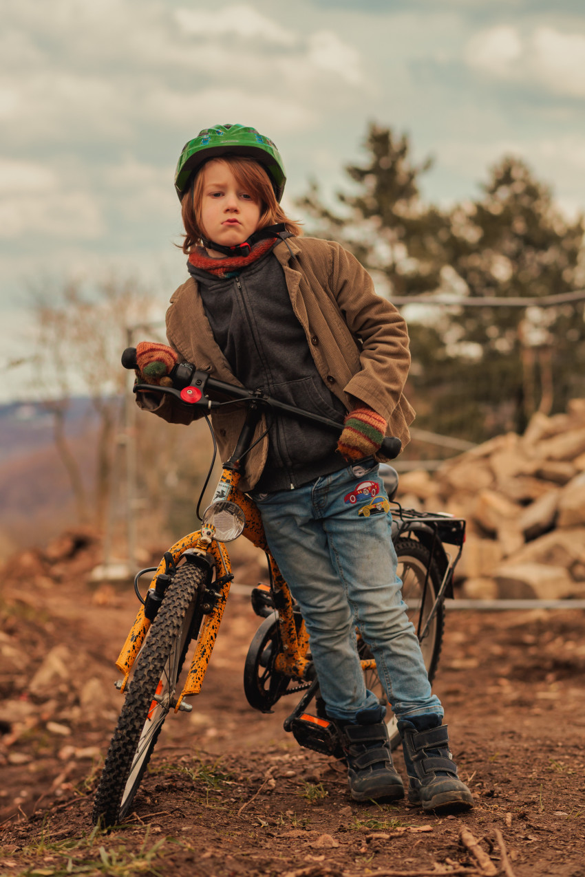 Boy with his yellow bike