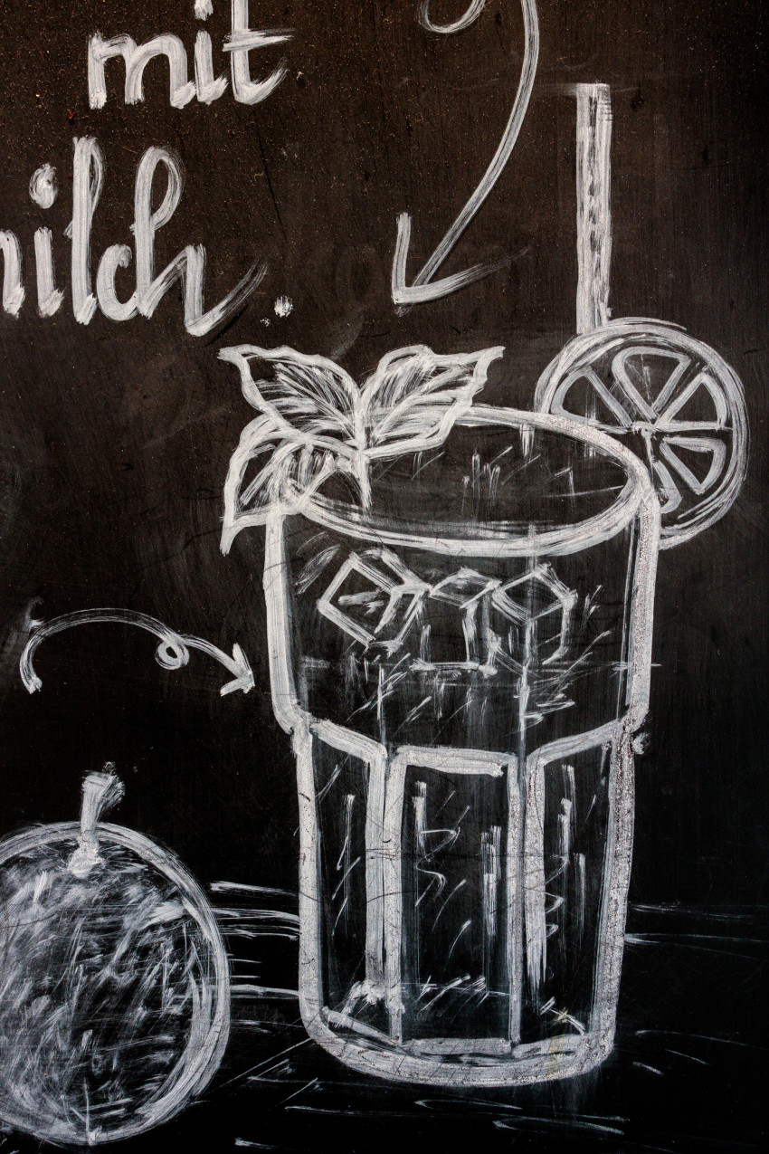 Caipirinha cocktail drawn with chalk on a blackboard