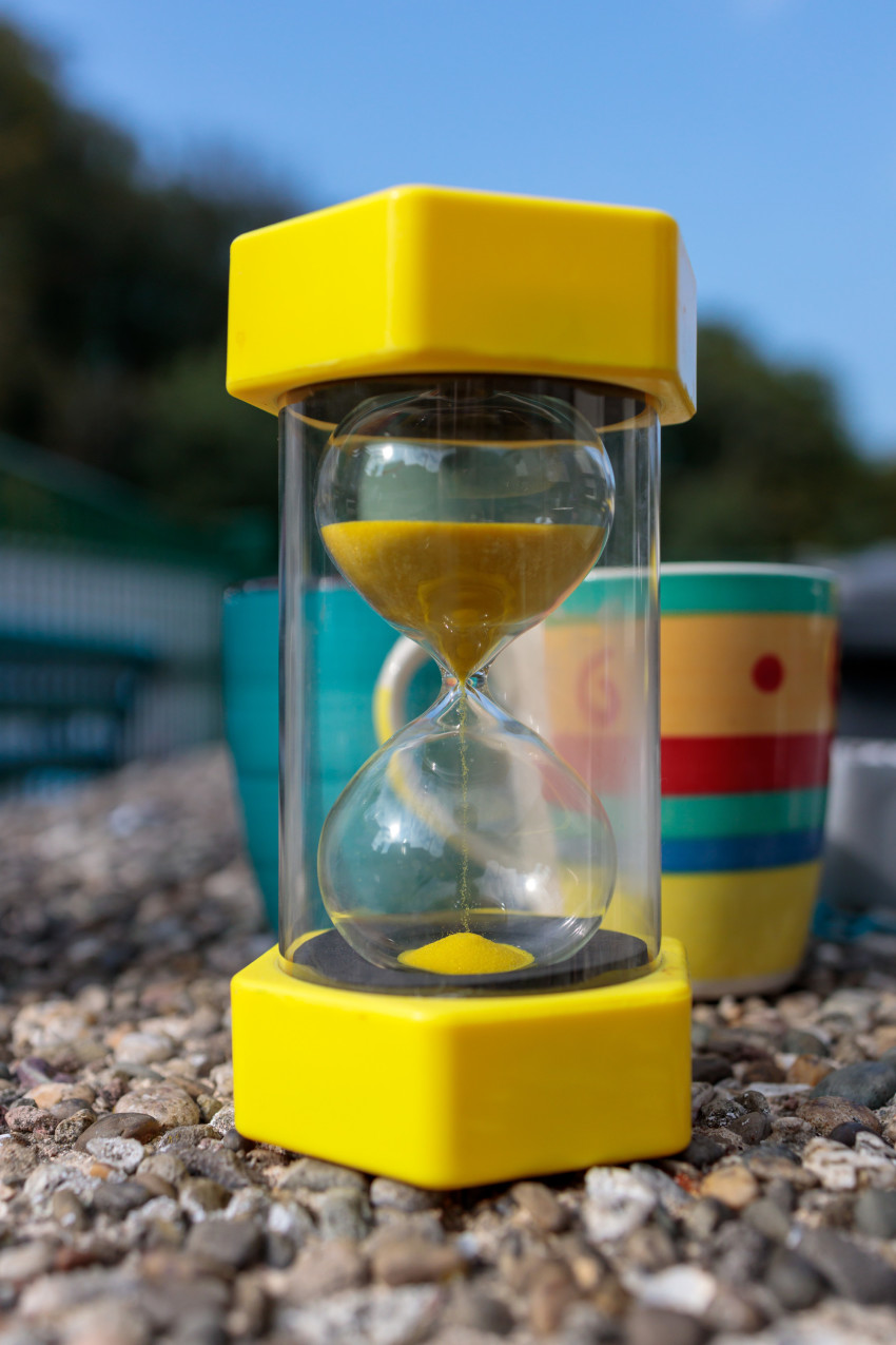 hourglass timepiece consisting of two glass bulbs