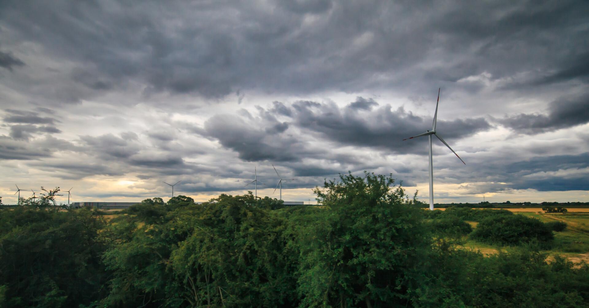 Wind farm dark storm clouds