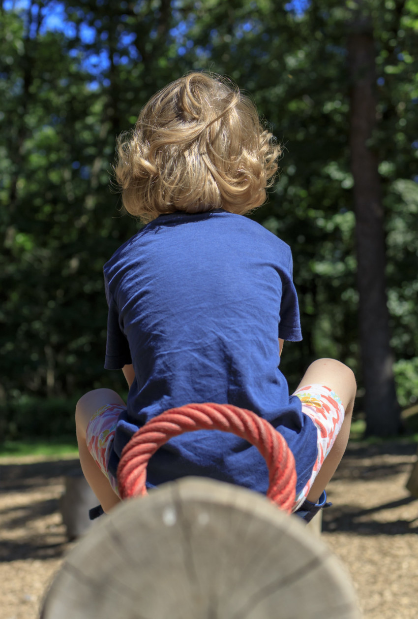 Child on a seesaw