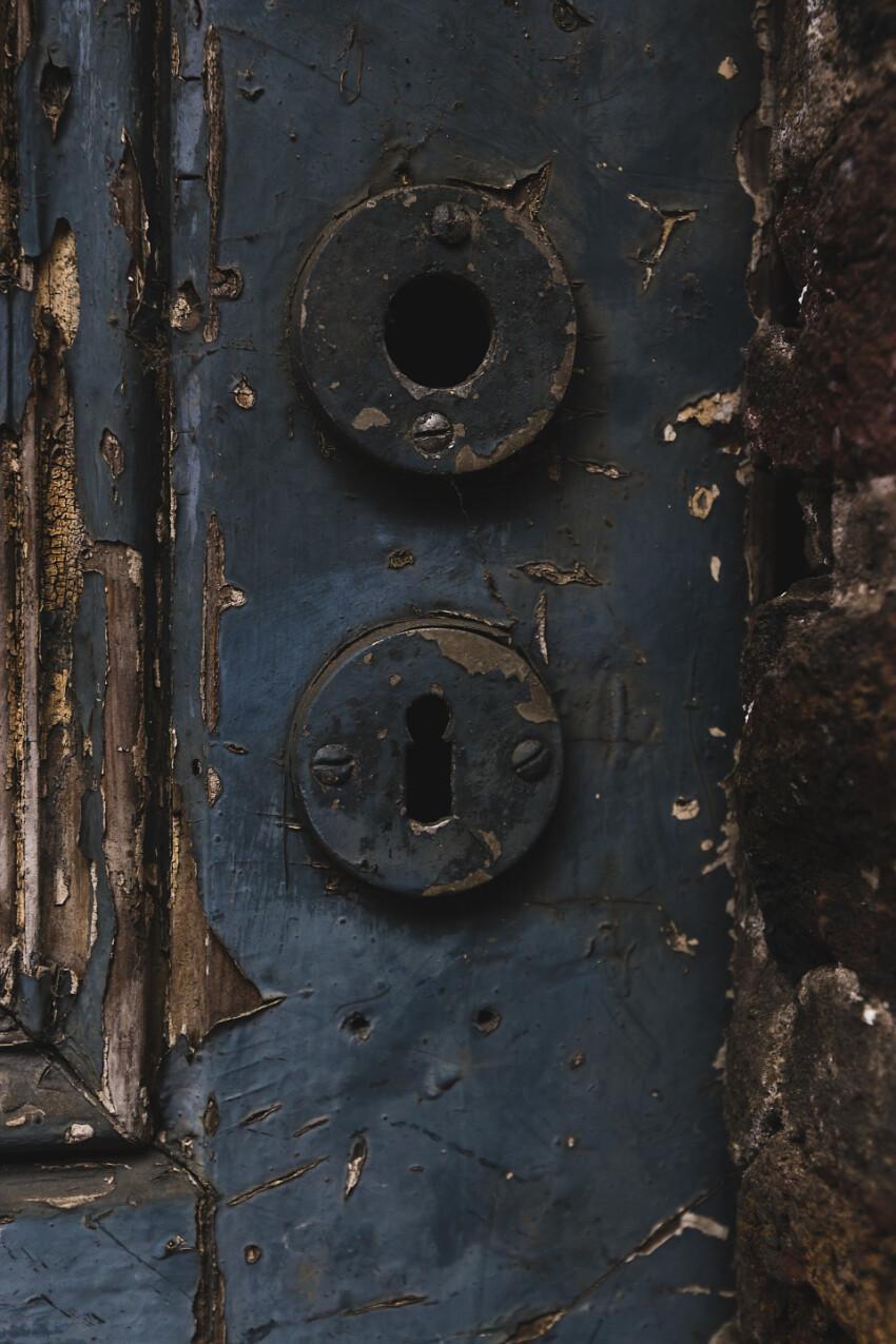 old blue weathered door lock