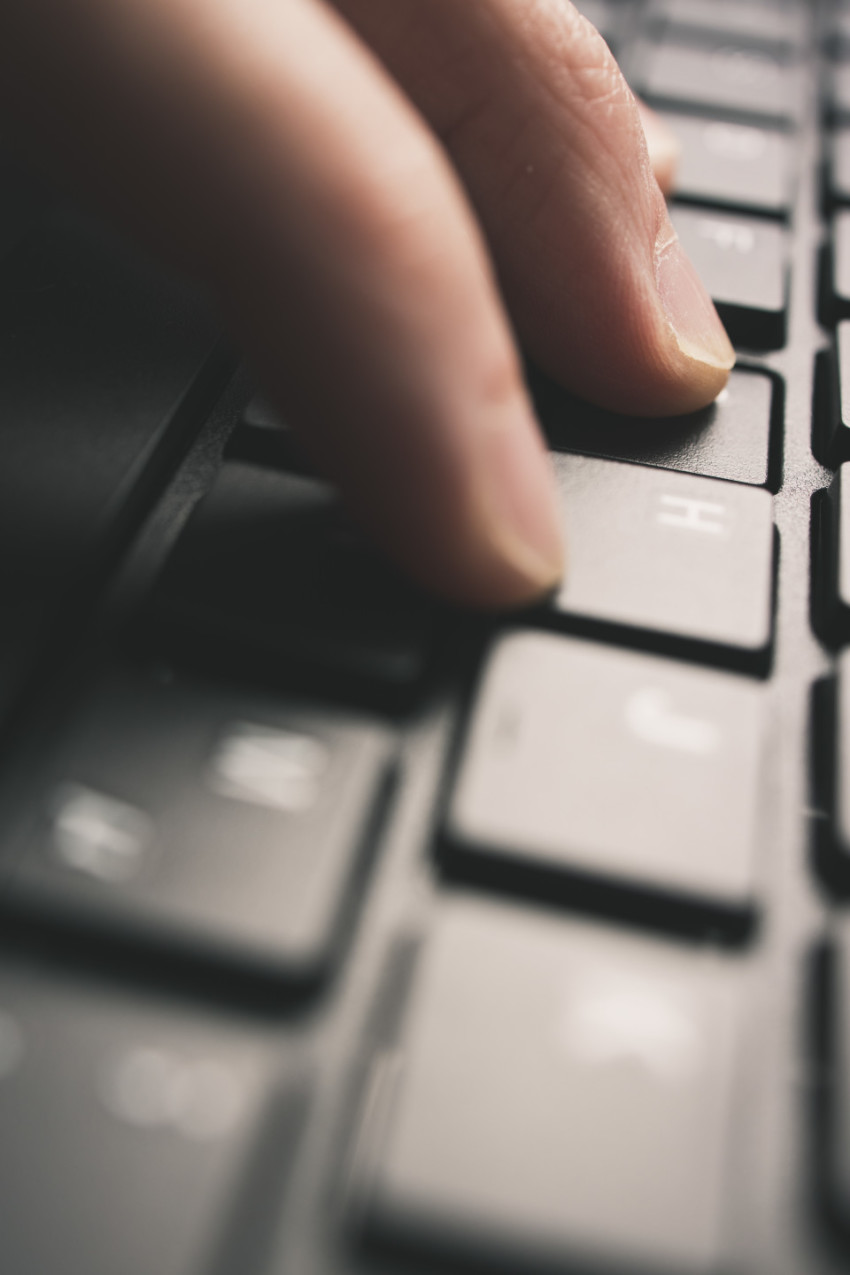 Detailed view of man is tipping on a computer keyboard