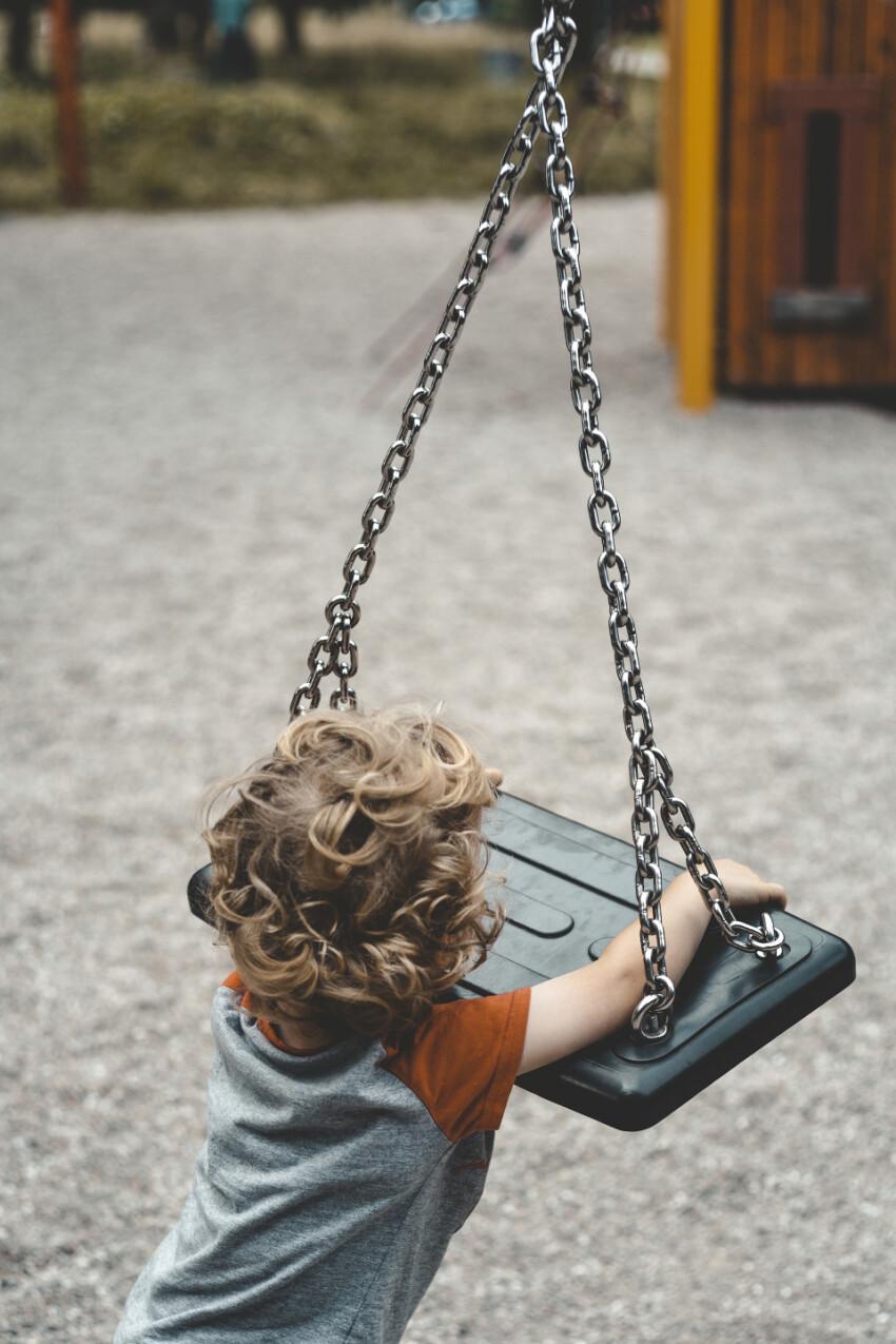 child turns on swing