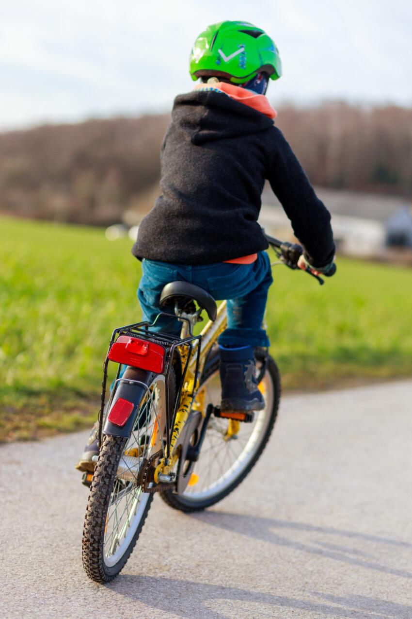 Boy riding bike in a helmet