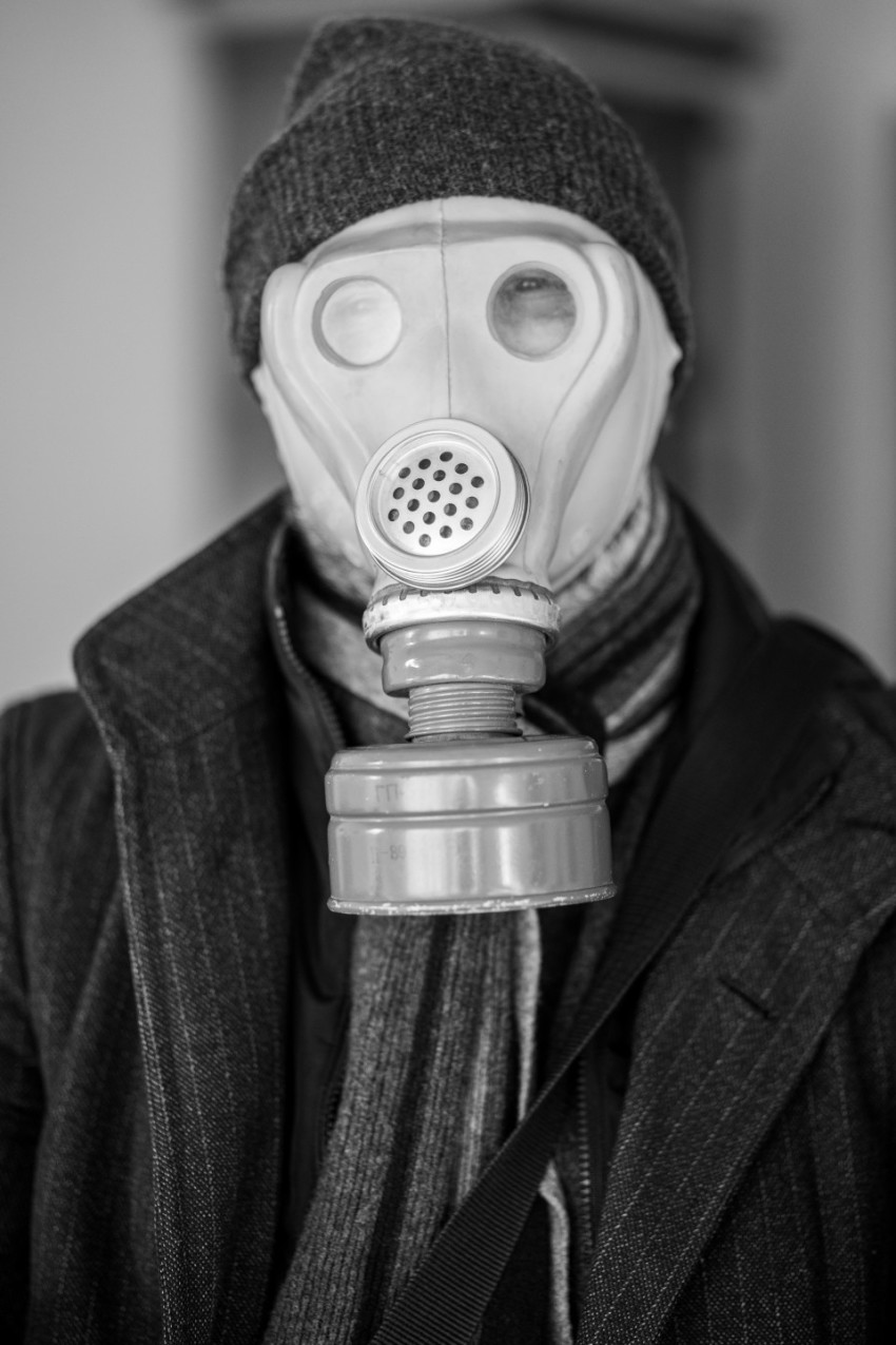 Man with gas mask goes to work