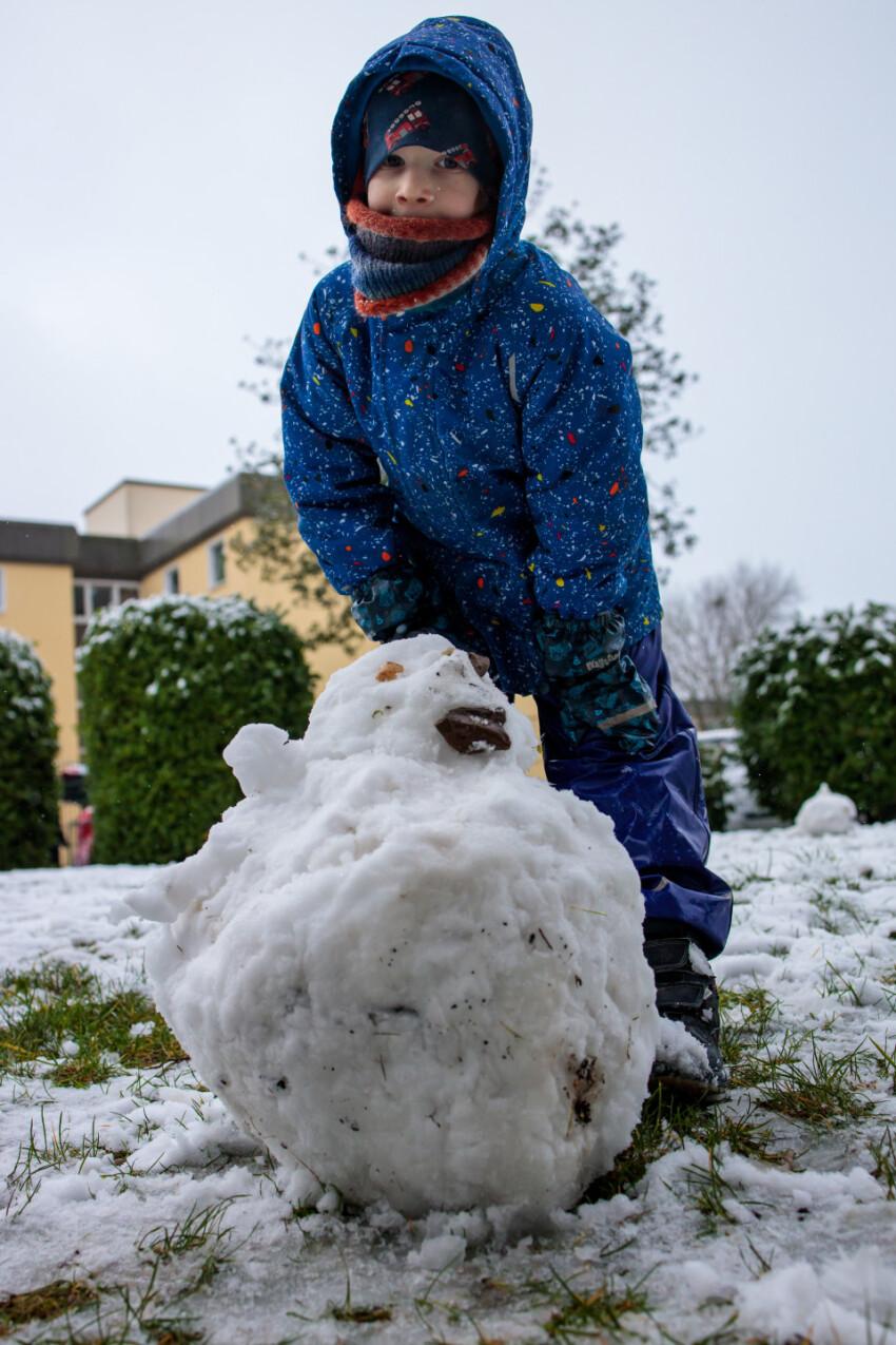 Little boy built a snowman