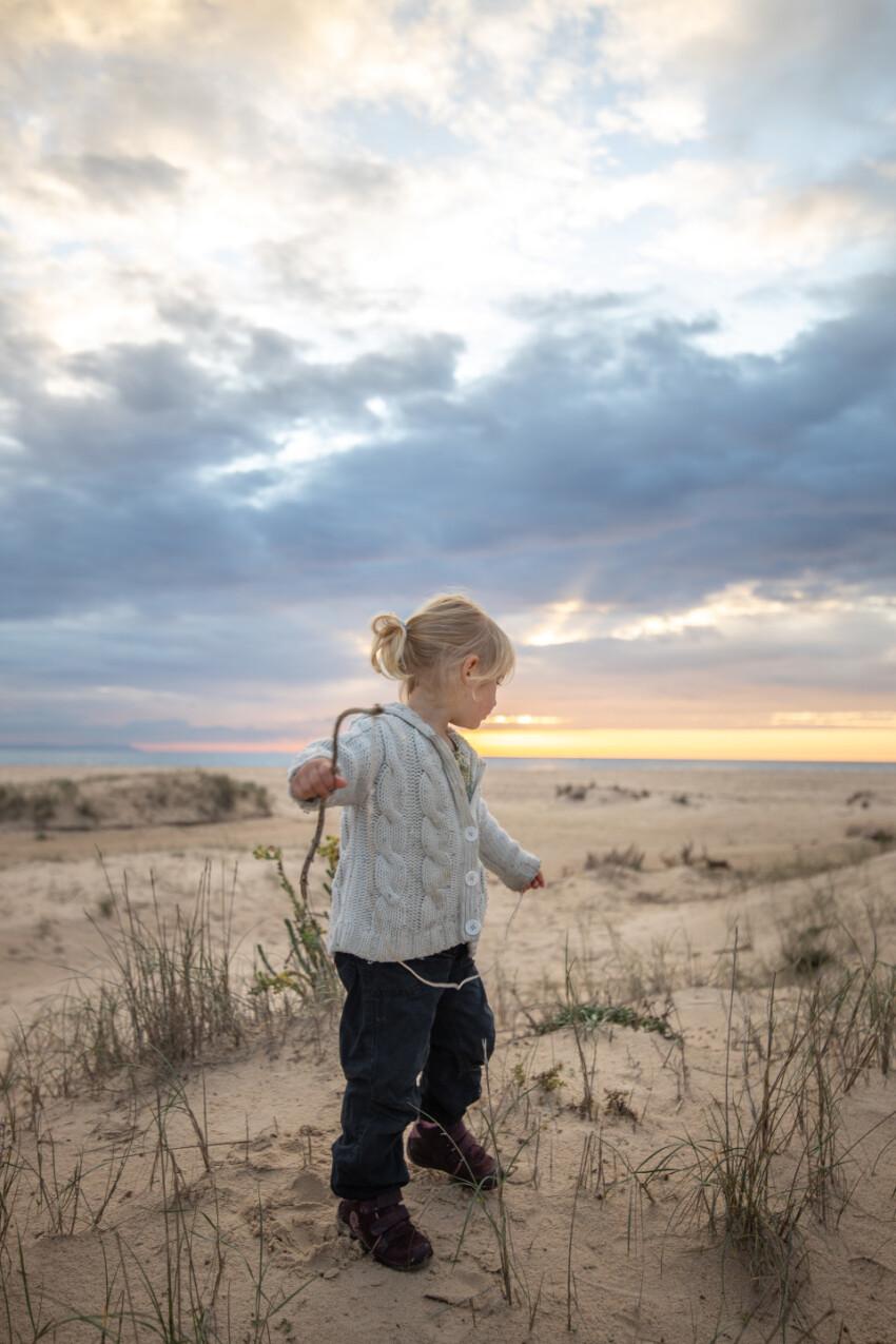 Cute girl on a sunset beach in spain