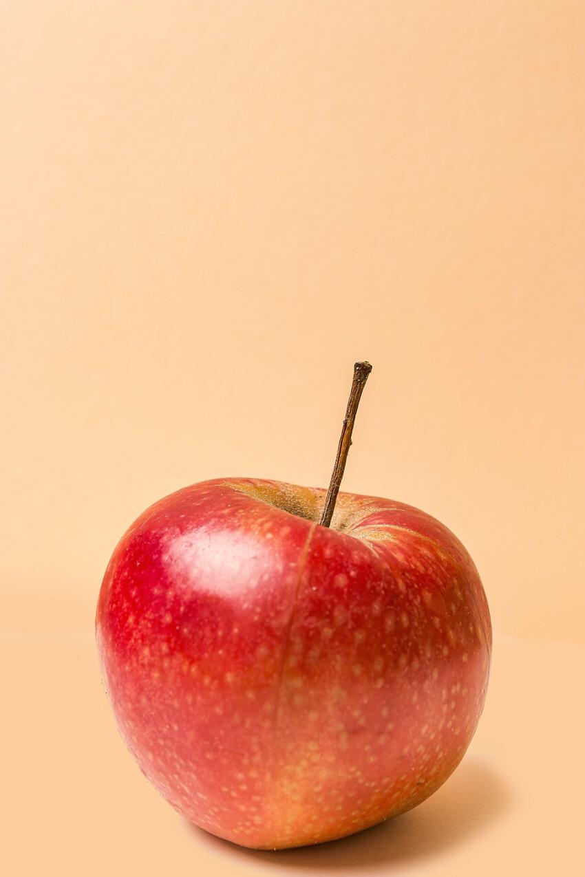 red apple beige background