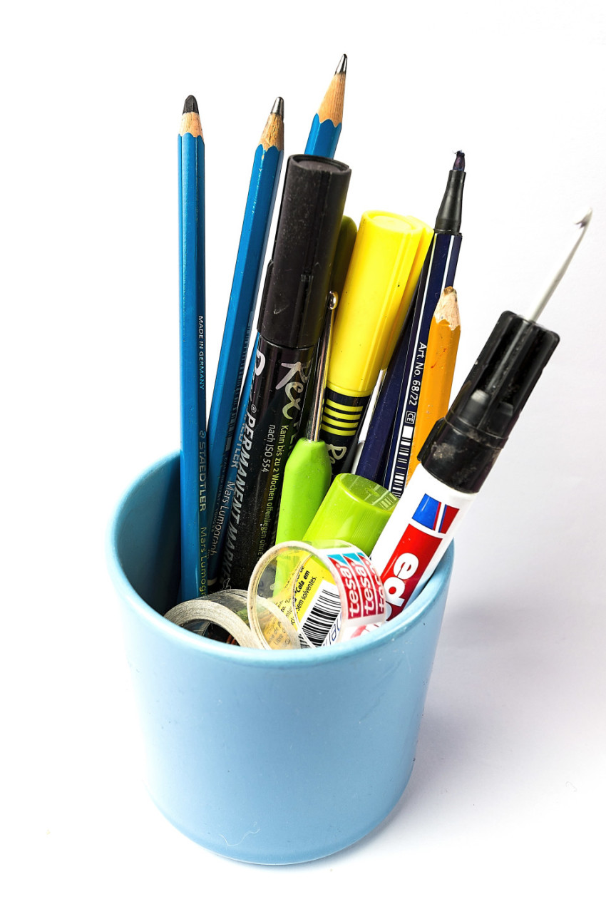 workplace utensils in mug
