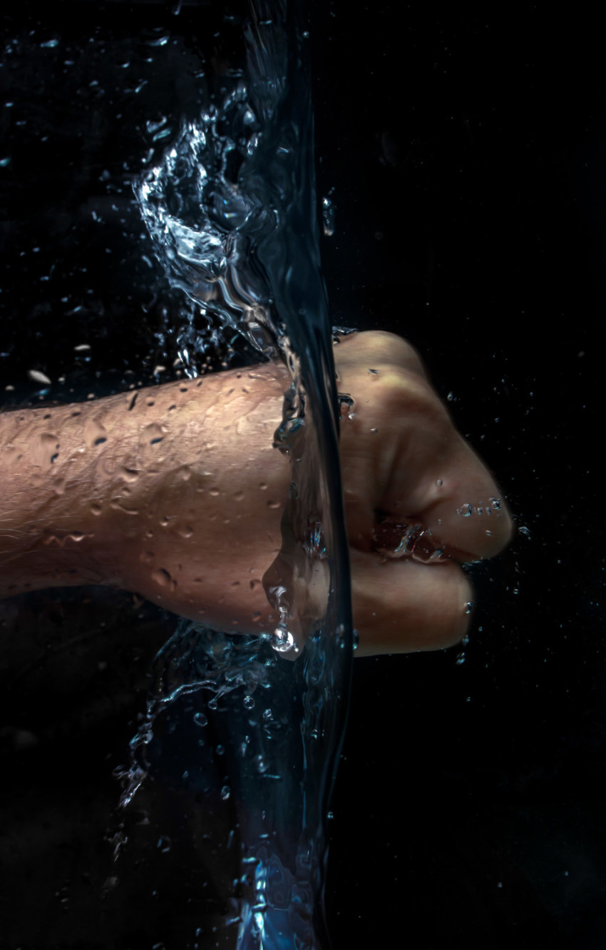 Power in hands - A fist strikes through water