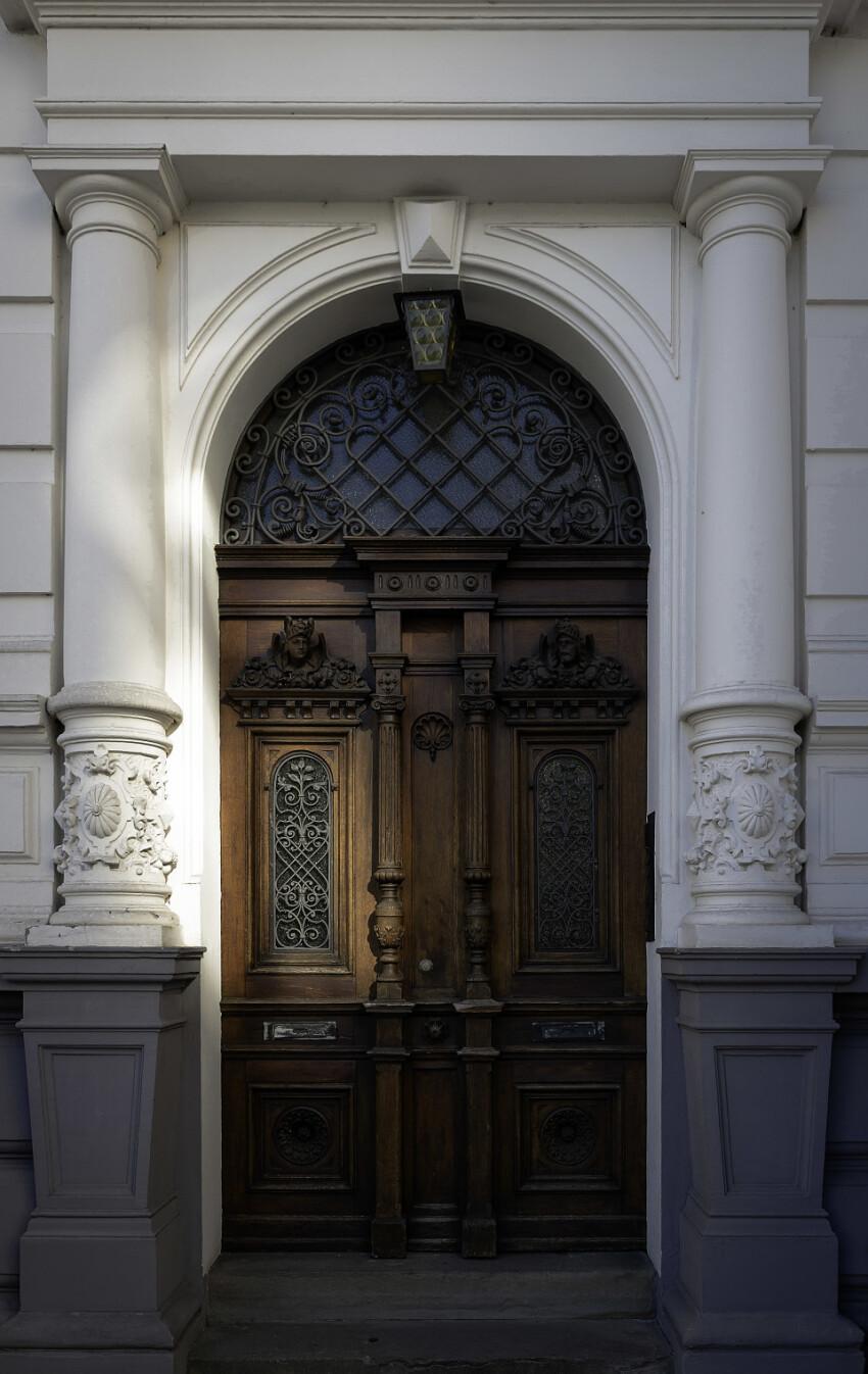 wooden door old white house
