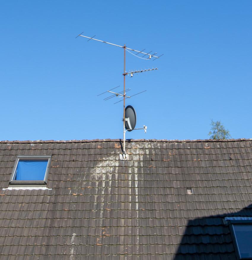 Satellite Dish and Antenna TV on Blue Sky