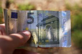 Stock Image: 5 euros in man hand