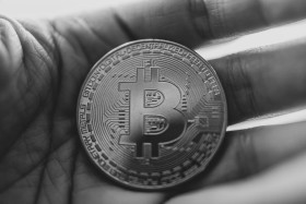 Stock Image: Bitcoin lying in the hand