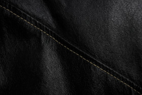 Stock Image: Black leather texture background with seam