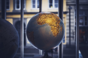 bluish globe on a windowsill