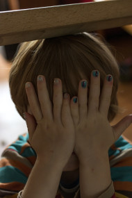 child with nail polish finger