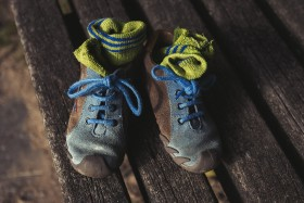 Stock Image: childrens shoes on a park bench topview