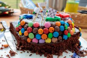 Stock Image: Chocolate birthday cake with cars