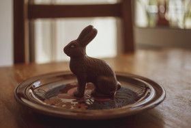 Chocolate Easter bunny on a brown plate in the dining room