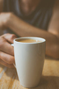 Stock Image: coffee cup in hand