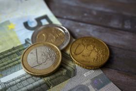 Stock Image: Euro money on wooden background
