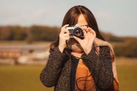Stock Image: Female photographer with analog camera