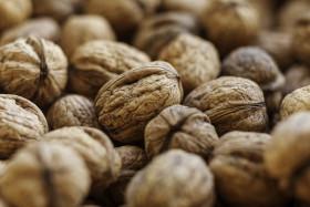 Stock Image: freshly harvested organic walnuts background