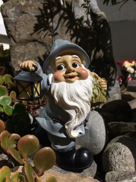 Stock Image: Garden gnome with lantern in hand