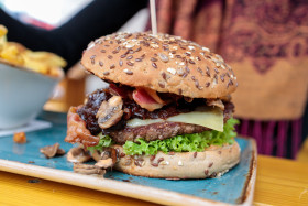 Stock Image: Hamburger with cheese and pickled onions