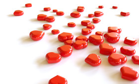 Stock Image: Heap of red hearts on white background