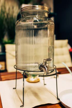 Stock Image: Juice dispenser on a set table