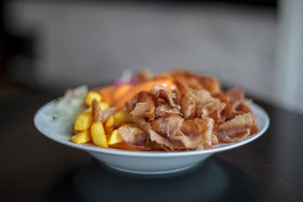 Stock Image: kebab and french fries on a plate