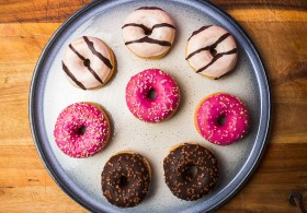 Stock Image: mixed donuts on a plate wood background
