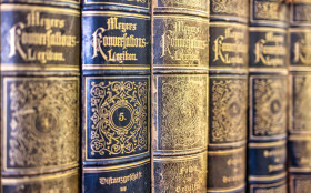 Stock Image: Old books in the library