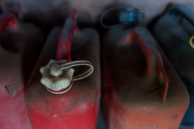 Stock Image: Old red canisters in a shed